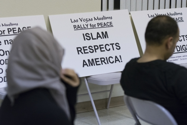 Signage stating the messages to be conveyed are seen at Jamia Masjid Mosque during an interfaith prayer vigil to remember the victims and the family of the Dec. 2 mass shooting in San Bernardino,  ...