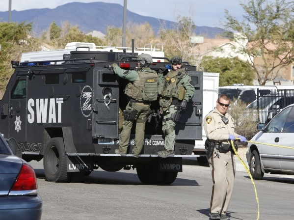 Metro SWAT unit and a Metro officer are on scene of a barricade situation near the intersection of Craig Road and Nellis Boulevard on Monday, Dec. 14, 2015. Bizuayehu Tesfaye/Las Vegas Review-Jour ...