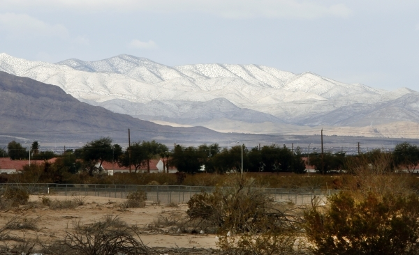 Snow capped mountains seen from North Las Vegas Monday, Dec. 14, 2015. The Las Vegas Valley will be breezy and cool Monday and temperatures are expected to really drop for Tuesday. Bizuayehu Tesfa ...