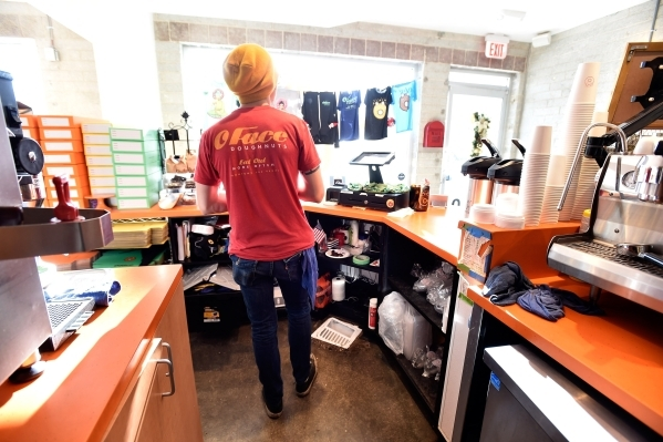 Barista Danny Chandia waits for customers at the O Face Doughnut shop in Downtown Las Vegas on Monday, Dec. 14, 2015.  The store, backed by the Downtown Project, is set to close later this month.  ...