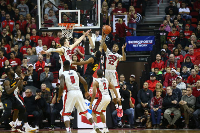 UNLV guard Patrick McCaw (22) blocks a shot by Arizona State forward Willie Atwood (2) as UNLV forward Stephen Zimmerman Jr. (33) also defends during a basketball game at the Thomas & Mack Cen ...