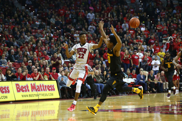 UNLV guard Patrick McCaw (22) makes a pass as Arizona State guard Tra Holder (0) attempts to block during a basketball game at the Thomas & Mack Center in Las Vegas on Wednesday, Dec. 16, 2015 ...