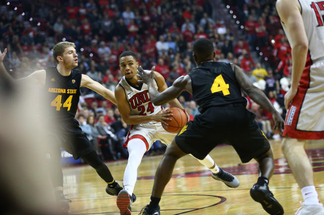 UNLV guard Jalen Poyser (24) drives against Arizona State guards Kodi Justice (44) and Gerry Blakes (4) during a basketball game at the Thomas & Mack Center in Las Vegas on Wednesday, Dec. 16, ...