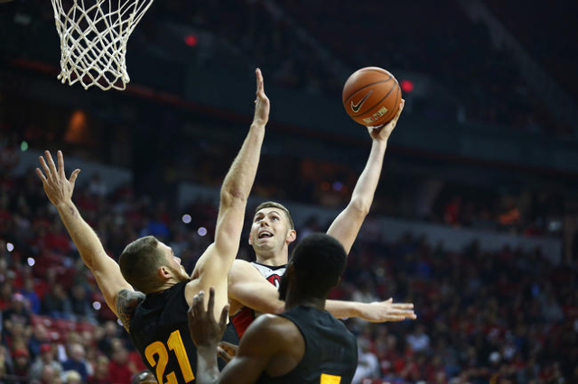 UNLV forward Ben Carter (13) shoots over Arizona State forward Eric Jacobsen (21) during a basketball game at the Thomas & Mack Center in Las Vegas on Wednesday, Dec. 16, 2015. Chase Stevens/L ...
