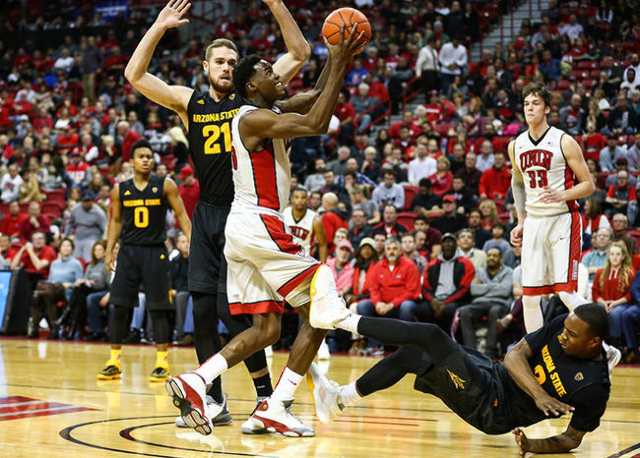UNLV forward Dwayne Morgan (15) shoots to score as Arizona State forward Willie Atwood (2) trips up and Arizona State forward Eric Jacobsen (21) defends during a basketball game at the Thomas &amp ...