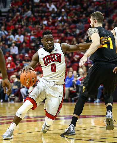 UNLV guard Ike Nwamu (0) drives past Arizona State forward Eric Jacobsen (21) during a basketball game at the Thomas & Mack Center in Las Vegas on Wednesday, Dec. 16, 2015. Arizona State won 6 ...