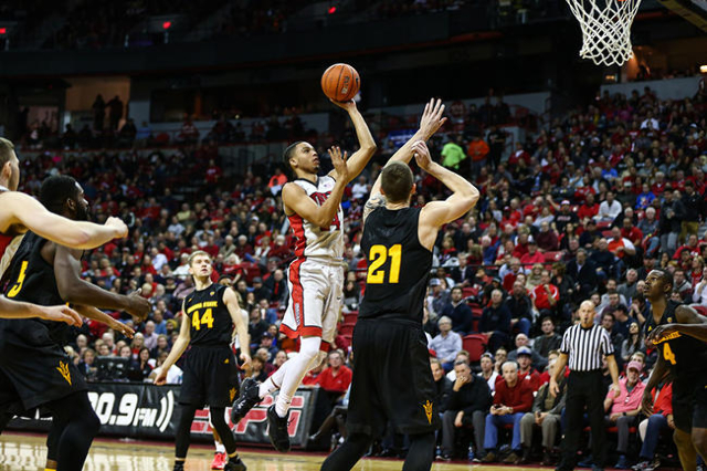 UNLV guard Jalen Poyser (24) jumps for a shot over Arizona State forward Eric Jacobsen (21) during a basketball game at the Thomas & Mack Center in Las Vegas on Wednesday, Dec. 16, 2015. Arizo ...