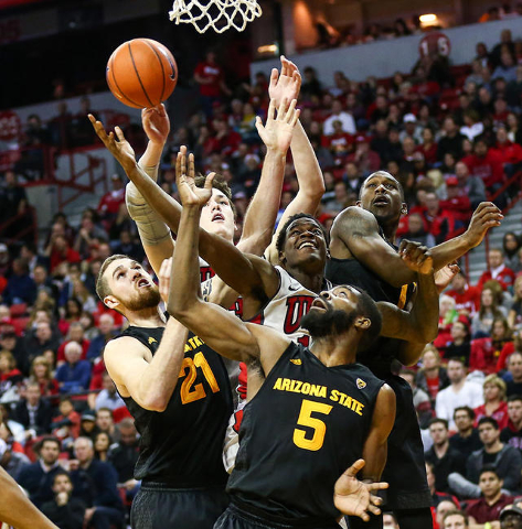 UNLV and Arizona State players, including forward Eric Jacobsen (21) and forward Obinna Oleka (5), reach for a rebound during a basketball game at the Thomas & Mack Center in Las Vegas on Wedn ...
