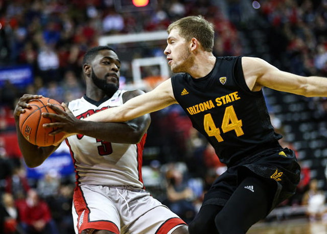 Arizona State guard Kodi Justice (44) attempts to get the ball from UNLV guard Jordan Cornish (3) during a basketball game at the Thomas & Mack Center in Las Vegas on Wednesday, Dec. 16, 2015. ...