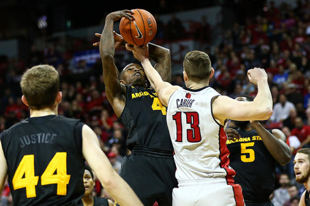 UNLV forward Ben Carter (13) and Arizona State guard Gerry Blakes (4) fight for the ball during a basketball game at the Thomas & Mack Center in Las Vegas on Wednesday, Dec. 16, 2015. Arizona  ...