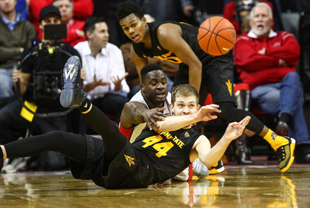 UNLV guard Ike Nwamu (0) and Arizona State guard Kodi Justice (44) attempt to gain control of the ball during a basketball game at the Thomas & Mack Center in Las Vegas on Wednesday, Dec. 16,  ...