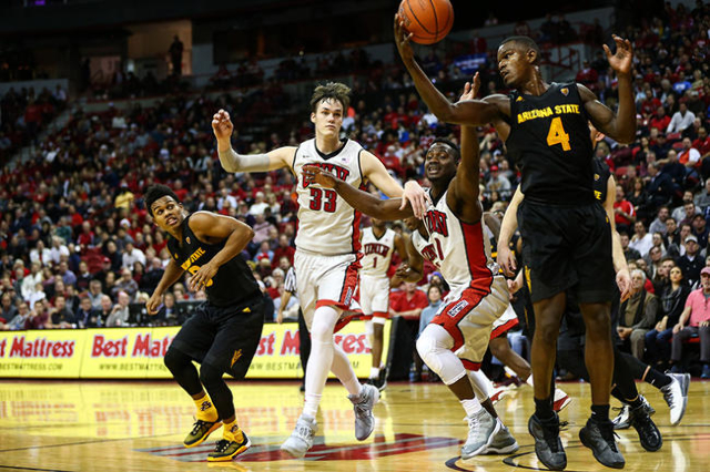 Arizona State guard Gerry Blakes (4) gets the rebound as UNLV forward Stephen Zimmerman Jr. (33) and UNLV guard Ike Nwamu (0) chase after during a basketball game at the Thomas & Mack Center i ...