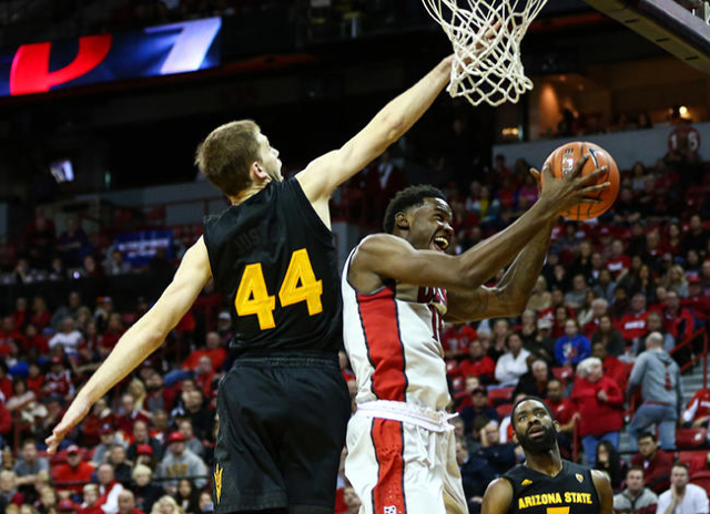 UNLV forward Dwayne Morgan (15) attempts a shot as Arizona State guard Kodi Justice (44) defends during a basketball game at the Thomas & Mack Center in Las Vegas on Wednesday, Dec. 16, 2015.  ...