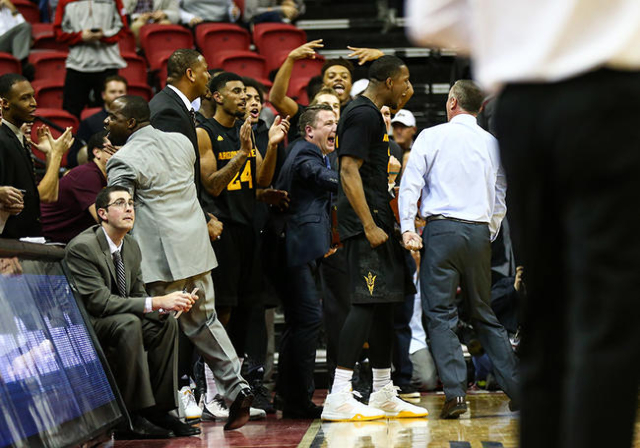 Arizona State players and staff react as their lead over UNLV grows during a basketball game at the Thomas & Mack Center in Las Vegas on Wednesday, Dec. 16, 2015. Arizona State won 66-56 over  ...