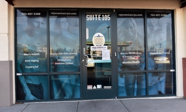 A notice is displayed on the front door of the former Rejuvenice spa at 8846 Eastern Ave. on Friday, Dec. 18, 2015. A 24-year-old worker was found dead inside a cryotherapy machine in October at t ...
