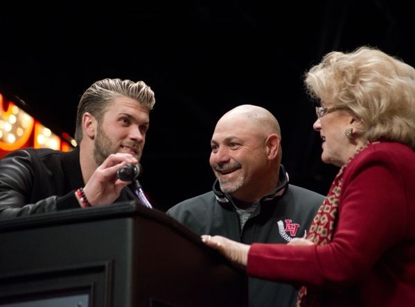 Baseball star Bryce Harper, left, speaks while his high school coach, Sam Thomas, and Mayor Carolyn Goodman listen on the Third Street Stage inside the Fremont Street Experience in downtown Las Ve ...