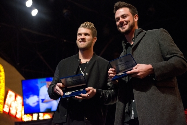Baseball stars Bryce Harper, National League MVP, left, and Kris Bryant, National League Rookie of the Year, show off their keys to the city after receiving them from Mayor Carolyn Goodman on the  ...