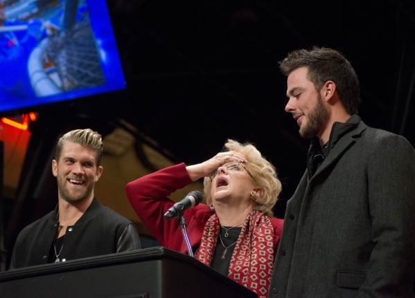 Las Vegas Mayor Carolyn Goodman speaks on stage with Bryce Harper, left, National League MVP, and Kris Bryant, National League Rookie of the Year, before they accept keys to the city on the Third  ...