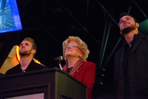 Bryce Harper, left, National League MVP, Las Vegas Mayor Carolyn Goodman, and Kris Bryant, National League Rookie of the Year, watch a video from the Third Street Stage inside the Fremont street e ...