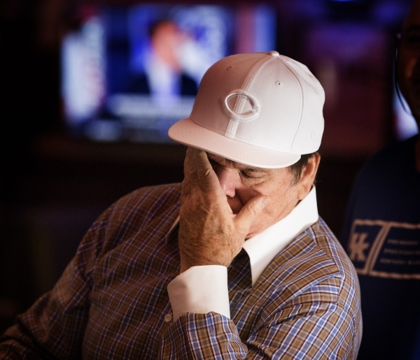 Major League Baseball all-time hits leader Pete Rose wipes his face while watching MLB Network inside Pete Rose Sports Bar and Grill, 3743 S Las Vegas Boulevard, after he conducted  a press confer ...