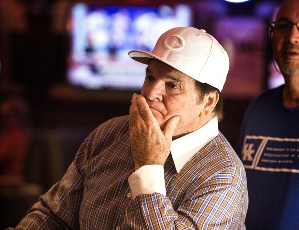 A dejected Major League Baseball all-time hits leader Pete Rose  watches MLB Network inside Pete Rose Sports Bar and Grill, 3743 S Las Vegas Boulevard, after he conducted  a press conference on Tu ...