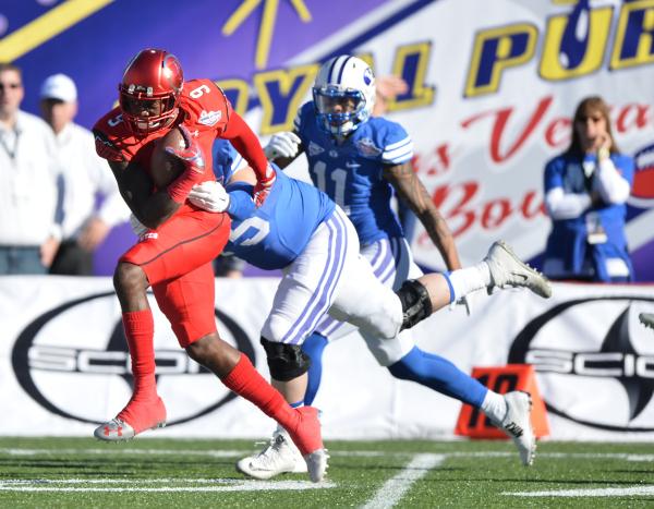 Utah defensive back Tevin Carter (9) returns an interception during the 2015 Royal Purple Las Vegas Bowl game between Utah and BYU at Sam Boyd Stadium on Saturday, Dec. 19, 2015, in Las Vegas. Bre ...