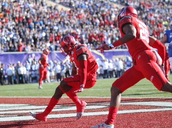 Utah defensive back Tevin Carter (9) celebrates a his interception and return for a touchdown during the 2015 Royal Purple Las Vegas Bowl game between Utah and BYU at Sam Boyd Stadium on Saturday, ...