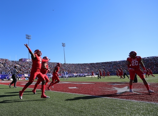 Utah defensive back Tevin Carter (9) celebrates his interception returned for a touchdown during the 2015 Royal Purple Las Vegas Bowl game between Utah and BYU at Sam Boyd Stadium on Saturday, Dec ...