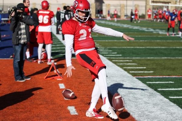 University of Utah's punter Tom Hackett (33) kicks the ball during a team practice at Bishop Gorman High School in Las Vegas Wednesday, Dec. 16, 2016. Erik Verduzco/Las Vegas Review-Journal  ...