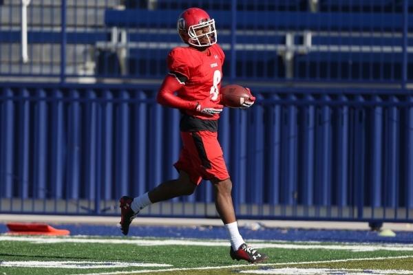 "University of Utah's James running back James ""Bubba"" Poole (8) runs the ball during a team practice at Bishop Gorman High School in Las Vegas Wednesday, Dec. 16, 2015. Erik Verduz ..."