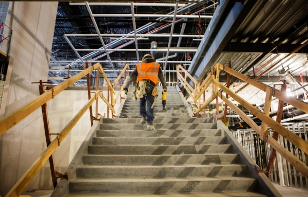 A workman climbs the stairs to the second floor of the Ikea store, at 215 Beltway at Durango Drive, on Thursday, Dec. 17,2015. The 351,000 square foot home furnishing store is scheduled to open ne ...