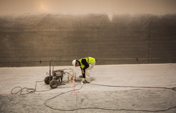 A worker wipes paint  the warehouse area of the store, at 215 Beltway at Durango Drive, on Thursday, Dec. 17,2015. The 351,000 square foot home furnishing store is scheduled to open next summer. J ...