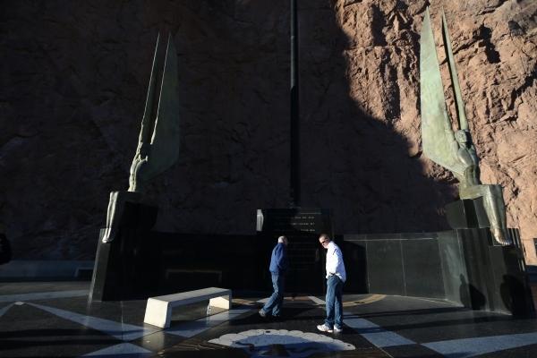 People tour the Winged Figures of the Republic at the Hoover Dam near Boulder City Thursday, Dec. 17, 2015. Erik Verduzco/Las Vegas Review-Journal Follow @Erik_Verduzco
