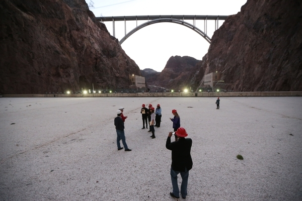 Members of Nuestro Rio, a Latino Colorado River conservation group, tour the roof of the central section of the Hoover Dam near Boulder City Thursday, Dec. 17, 2015. Erik Verduzco/Las Vegas Review ...