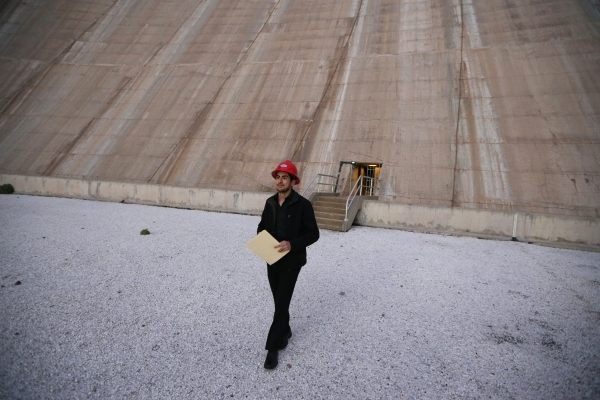 Hector Lizaola, member of Nuestro Rio, a Latino Colorado River conservation group, tours the roof the central section of the Hoover Dam near Boulder City Thursday, Dec. 17, 2015. Erik Verduzco/Las ...