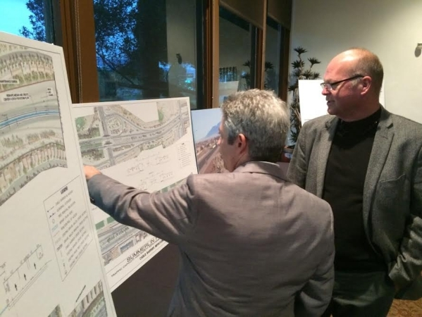 Eric Meyer, engineering project manager, shows Las Vegas City Councilman Bob Beers an area of interest concerning the proposed changes for the Summerlin Parkway Dec. 8 at Angel Park during a commu ...
