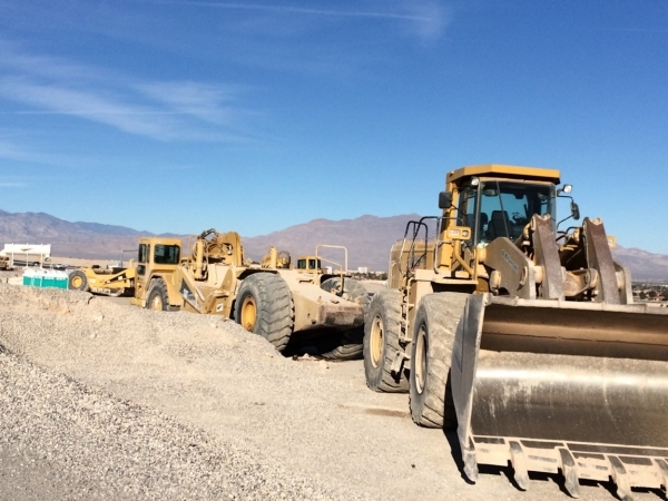 Road construction equipment sits at the intersection of the 215 Beltway and Lone Mountain Road Dec. 19, to be used to change the interchange's configuration. The beltway eventually will see  ...