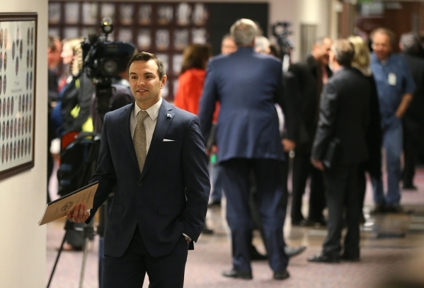 Nevada Assemblyman Derek Armstrong, R-Las Vegas, heads into the Assembly chambers at the Legislative Building in Carson City on Wednesday, Dec. 16, 2015. Gov. Brian Sandoval called lawmakers into  ...