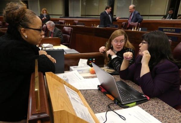 Assembly Democrats, from left, Dina Neal, Maggie Carlton and Irene Bustamante Adams work at the Legislative Building in Carson City on Wednesday, Dec. 16, 2015. Gov. Brian Sandoval called lawmaker ...