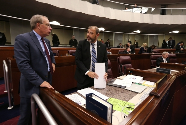 Nevada Assembly Republicans Pat Hickey and Paul Anderson talk on the Assembly floor at the Legislative Building in Carson City on Wednesday, Dec. 16, 2015. Gov. Brian Sandoval called lawmakers int ...