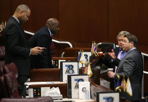 Nevada Senate Democrats, from left, Aaron Ford, Kelvin Atkinson and Tick Segerblom talk with Senate Majority Leader Michael Roberson, R-Henderson, at the Legislative Building in Carson City, Nev., ...