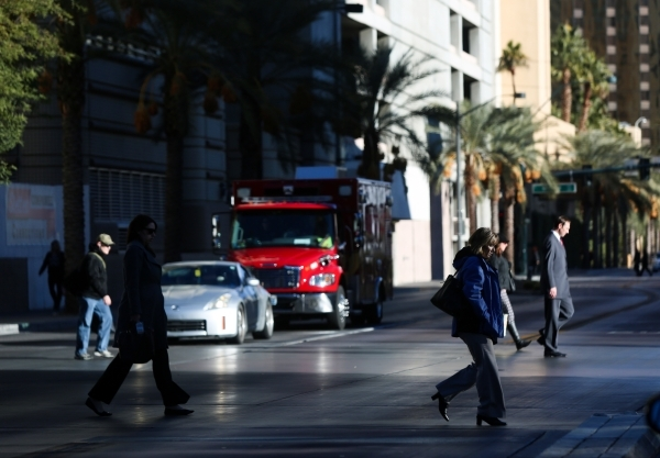 Pedestrians cross Casino Center Boulevard on Thursday, Dec. 17, 2015. Brett Le Blanc /Las Vegas Review-Journal Follow @bleblancphoto
