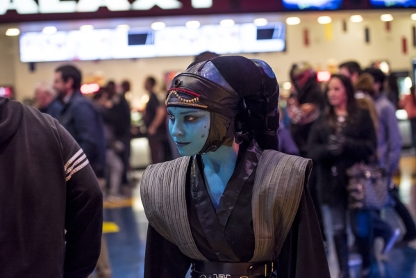 """Sarah Turner walks through the lobby during opening night of """"Star Wars: The Force Awakens"""" at the Galaxy Theaters at the Cannery hotel-casino  in Las Vegas on Thursday, Dec. 17, 2015. J ..."""