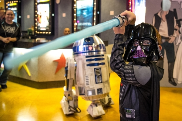 """Joaquin Valdez, 6, poses for a photo during opening night of """"Star Wars: The Force Awakens"""" at the Galaxy Theaters at the Cannery hotel-casino  in Las Vegas on Thursday, Dec. 17, 2015. J ..."""