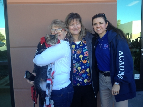 Christy Santoro, left, from the Poppy Foundation holds Tommy Cat Santoro, with Linda Newman, center, president of the foundation, and fourth-grade teacher Christine Schirg, right, Dec. 18 at the F ...