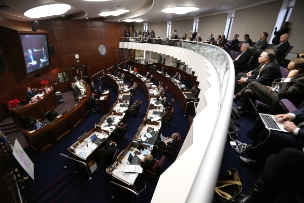Members of the state Senate work as a Committee of the Whole during a special session at the Legislative Building in Carson City on Thursday, Dec. 17, 2015. Lawmakers continue to hear details of a ...