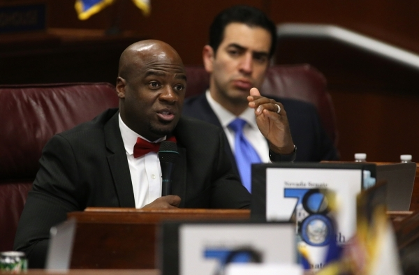 Nevada Senate Democrats Kelvin Atkinson, left, and Ruben Kihuen work in a Committee of the Whole hearing during a special session at the Legislative Building in Carson City on Thursday, Dec. 17, 2 ...