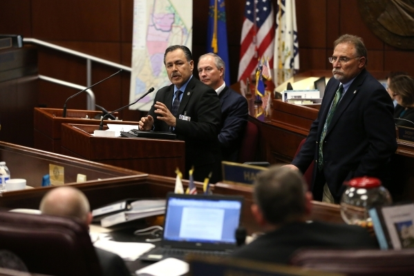 Gov. Brian Sandoval administration officials, from left, Rudy Malfabon, Steve Hill and Mike Willden testify before the Nevada Senate Committee of the Whole at the Legislative Building in Carson Ci ...