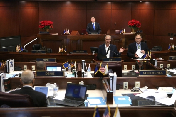 Gov. Brian Sandoval administration officials Steve Hill, left center, and Mike Willden testify before the Nevada Senate Committee of the Whole at the Legislative Building in Carson City on Thursda ...