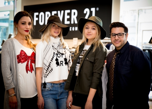 Maria Matta-Caro, FashionTrend.Vegas editor, models Alona M and Claire S, wearing Forever 21 and Zar Zanganeh Valley View Live co-host at Downtown Summerlin. Photo Credit Tonya Harvey.